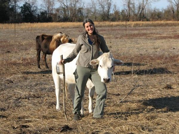 <p>Janisse Ray with her cow, Emma, on her farm in Georgia. The writer gave up flying out of concern over carbon emissions and climate change.</p>