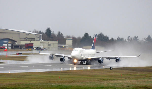 A Delta Air Lines 747 lands at Paine Field near Everett, Washington, on a rainy Monday during the airline's farewell tour for the ''Queen of the Skies.''
