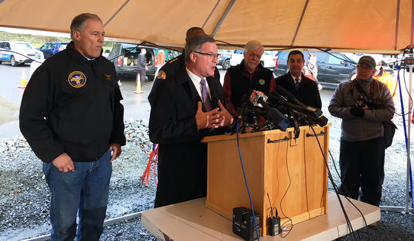 Pierce County Executive Bruce Dammeier speaks at a news conference Tuesday near the site of an Amtrak Cascades train that derailed killing three. He was joined by Gov. Jay Inslee, left.