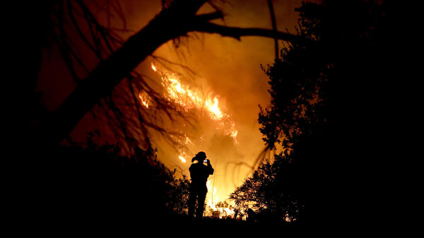 A firefighter snaps a quick picture amid efforts to contain the Thomas Fire in Montecito, Calif., earlier this month.