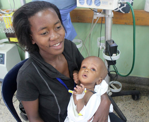 Aisha holds her baby daughter Faridah at CURE Children's Hospital of Uganda.