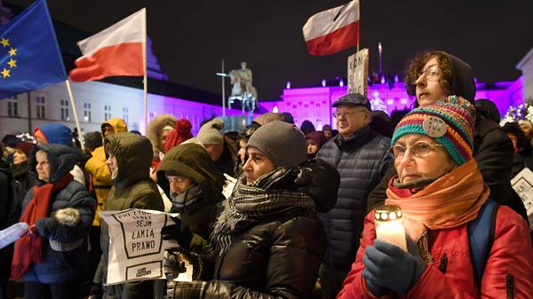 People protest in front of the presidential palace in Warsaw, Poland, earlier this month against controversial moves by the right-wing government that the EU insists undermine the rule of law and separation of powers.