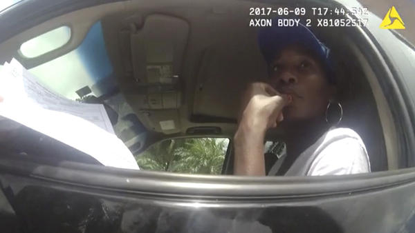 Venus Williams, seen in body camera footage from June, listens to a police officer following a car crash that fatally injured an elderly man.