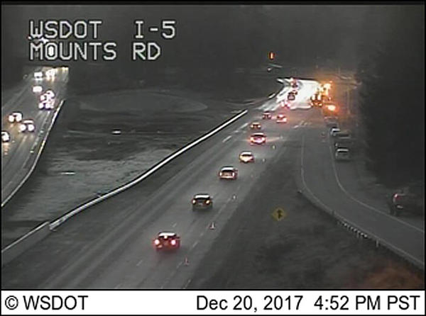 A WSDOT traffic camera shows the first cars to drive through the cleaned-up train wreck scene after I-5 southbound reopened.