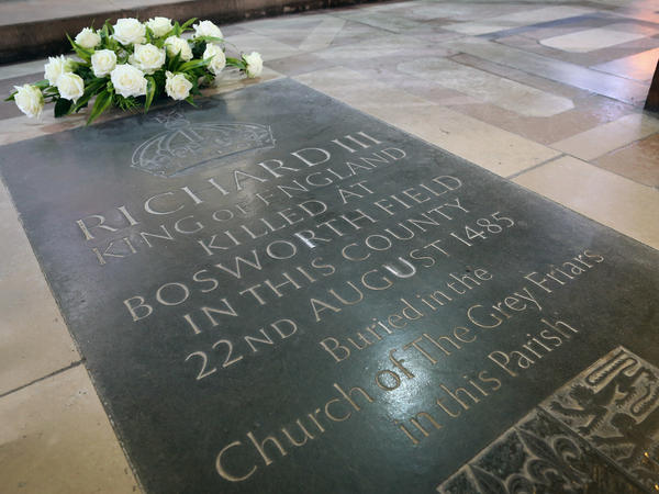Flowers sit on a memorial stone marking the death of King Richard III inside Leicester Catherdral, close to where the body of Richard III was discovered, on February 4, 2013 in Leicester, England.