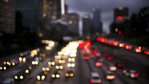 Traffic moves along the 110 Freeway in downtown Los Angeles on Wednesday. Wednesday and Thursday will be the season's busiest traffic day in the United States, according to AAA forecasts.