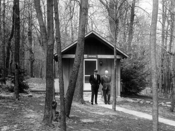 President John F. Kennedy and former President Dwight D. Eisenhower talk at Camp David in 1961.