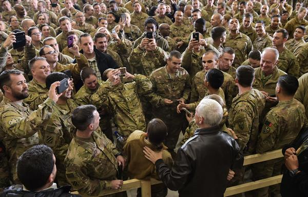 Vice President Pence poses for photos with troops after giving a speech in a hangar at Bagram Air Field in Afghanistan on Thursday.