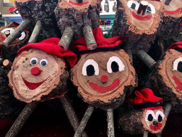 Caga Tiós, Catalan Christmas logs stacked up at a market in Girona, Spain.