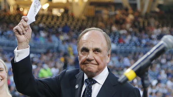 San Diego Padres broadcaster Dick Enberg waves to the crowd at a retirement ceremony prior to the Padres final home baseball game of the season on Sept. 29, 2016, in San Diego.