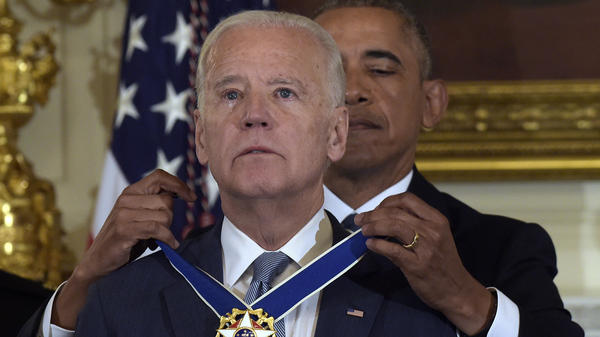 Then-President Obama presents Vice President Biden with the Presidential Medal of Freedom during a ceremony in the State Dining Room of the White House on Jan. 12.