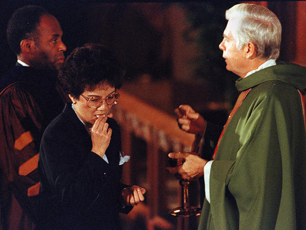 "Philippine President Corazon Aquino receives Holy Communion from Law at St. Ignatius Church in Newton, Mass., in 1986. Law was described in a 1990 newspaper article as ""the first Archbishop of Boston to have a foreign policy."""