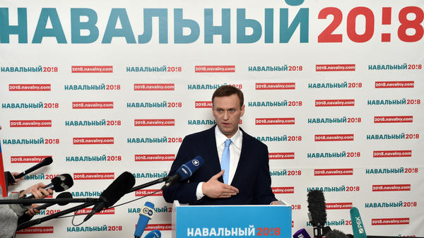Russian opposition leader Alexei Navalny delivers a speech during a meeting with his supporters in Moscow on Sunday. Navalny, seen as the only Russian opposition leader who stands a fighting chance of challenging strongman Vladimir Putin, was seeking to get his name on the ballot for a March vote, but on Monday an election commission voted to bar him from the election.