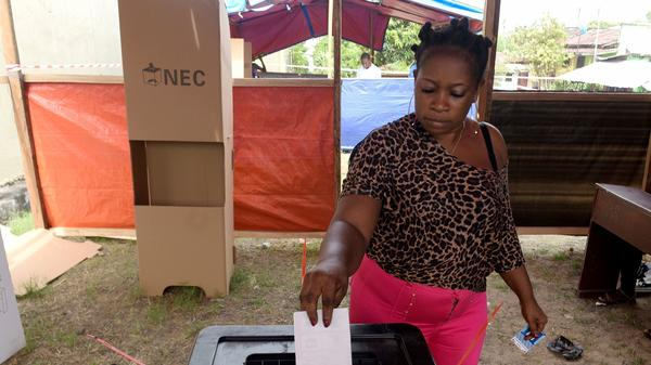 A woman casts her ballot at a polling station in Monrovia, Liberia, as Liberians go to the polls for the second round of presidential elections on Tuesday.
