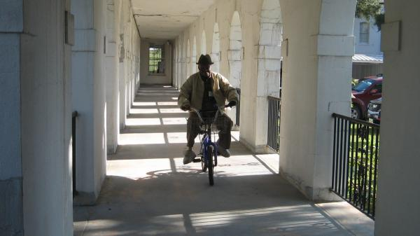 """Simeon Peterson, known as """"Mr. Pete,"""" in 2009. Patients at Carville leprosarium often used bicycles to get from building to building, which were connected by covered passageways."""