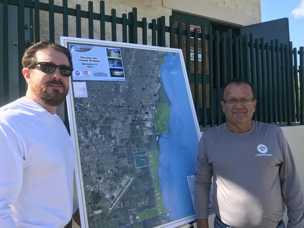 Federico Fernandez, left, and Bahram Charkian of the South Florida Water Management District say sawgrass and pond apples are among positive signs for the coastal ecosystem.