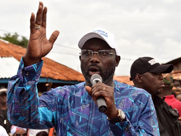 Liberian election officials said Thursday that soccer great George Weah, seen addressing an October campaign rally in Monrovia, had won the presidential runoff.