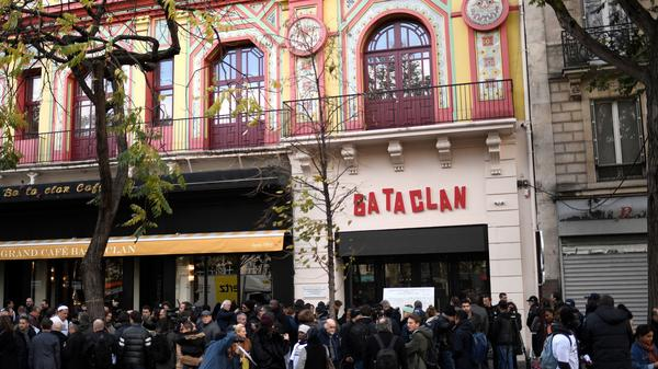 People in front of the Bataclan during ceremonies across Paris marking the second anniversary of the terror attacks of November 13, 2015.