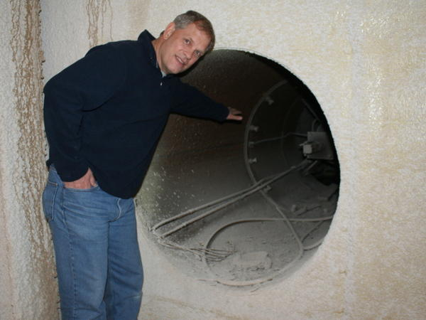 Larry Hall shows off the old vents and 9-foot-thick walls of a missile silo he's developing into condominiums.