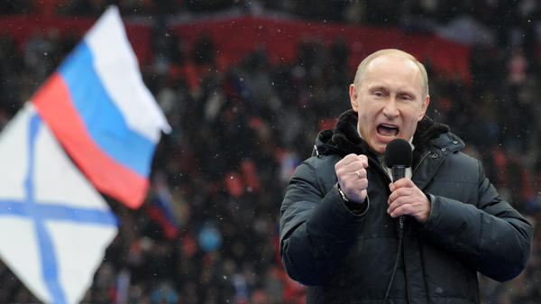 Prime Minister Vladimir Putin delivers a campaign speech during a rally of his supporters in Moscow, Feb. 23. Putin is mounting a vigorous campaign in the face of growing opposition but is expected to win Sunday's presidential elections.