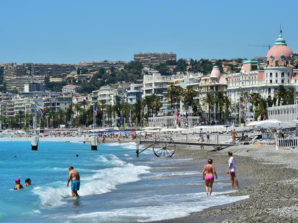 People visit the beach on July 16 in Nice. The Bastille Day attack took place on the adjacent Promenade des Anglais.
