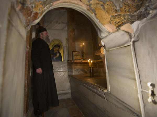 A Greek priest stands inside the renovated Edicule in the Church of the Holy Sepulchre on Monday.