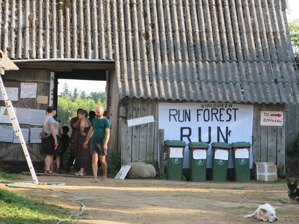 "The camp outside Białowieża National Park where environmental activists are staying as they try to stop loggers. They've hung a sheet that says: ""Bialowieza, Run Forest Run"" playing on the popular Tom Hanks movie ""Forrest Gump."""
