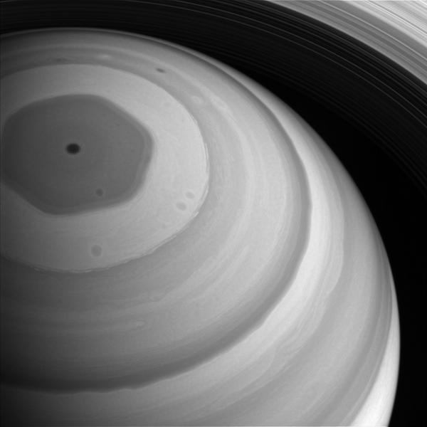 """Saturn's polar """"hexagonal storm"""" could engulf the entire Earth."""