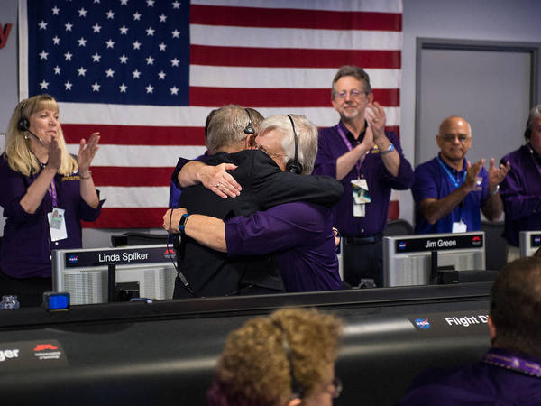 Earl Maize (left), Cassini program manager at JPL, and Julie Webster, spacecraft operations team manager for the Cassini mission at Saturn, embrace after the Cassini spacecraft plunged into Saturn on Friday at precisely 7:55 a.m. ET.