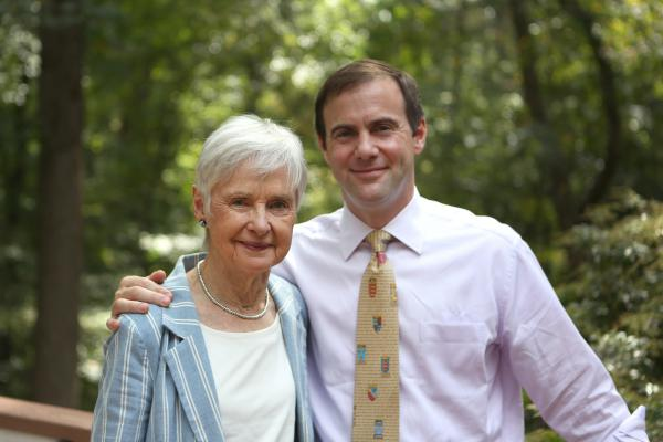 Maureen Scalia and her son Christopher stand on the back porch of the family's home in Virginia.