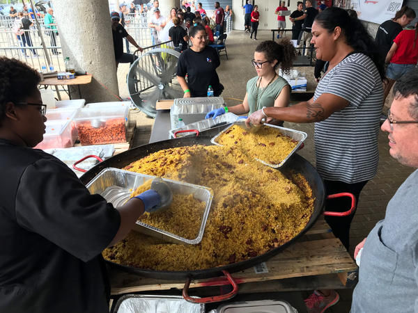 Volunteers prepare a giant paella. This pan alone holds enough to feed 850 people.
