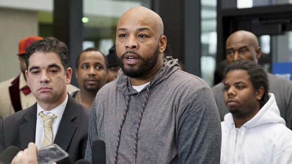 Leonard Gipson, one of 15 men who say corrupt Chicago police framed them and whose convictions were thrown out, talks to reporters Thursday.