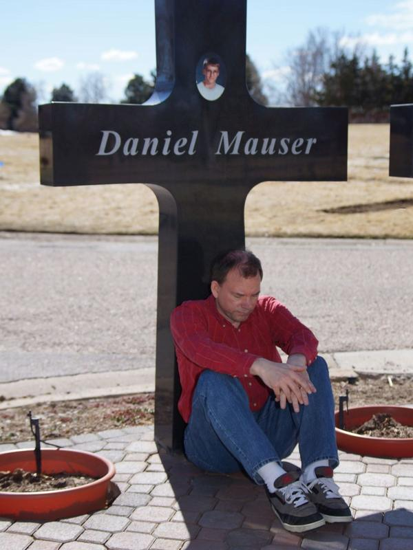 """Tom Mauser sometimes wears the shoes his son Daniel wore the day of the Columbine shooting. He says he gets """"strength from my son's shoes."""""""