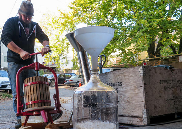 Anxo cider-maker Greg Johnson pulverizes apples into a juice that will later be fermented into hard cider.