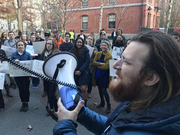 """Harvard graduate student Jack Nicoludis (right), who helped organize a campus protest on Wednesday, says the House tax bill would more than double his taxes. """"This plan is going to be disastrous for higher ed,"""" he says."""