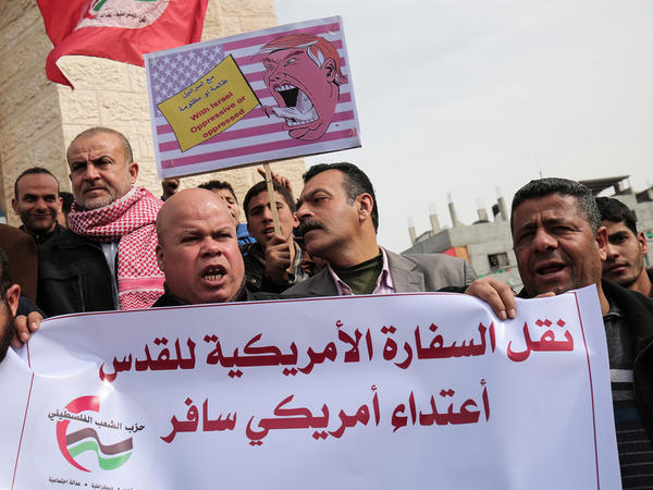 "Palestinian demonstrators protest President Trump's pledge to move the U.S. Embassy to Jerusalem, in Rafah in the southern Gaza Strip in January. The sign in Arabic reads: ""Moving the U.S. Embassy to Jerusalem is a flagrant aggression."""