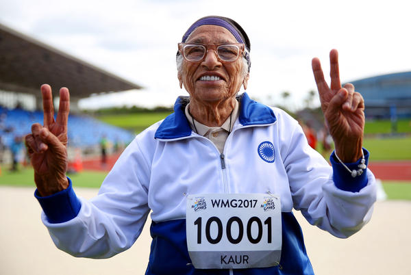 Man Kaur of India celebrates after competing in the 100-meter sprint in the 100+ age category at the World Masters Games in Auckland, New Zealand, in April.