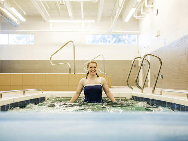 Team USA wrestler Jennifer Page trains in a pool at the Colorado Springs Olympic Training Center. She is recovering from an ACL surgery.