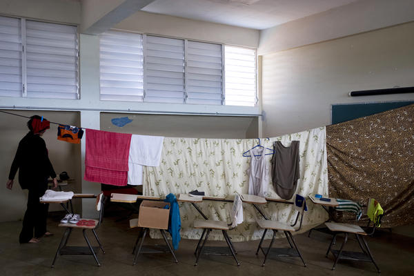 Families displaced by Hurricane Maria have been living at Liberata Iraldo middle school, which is serving as a shelter for people who lost their homes in the storm.