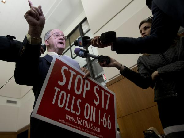 Then-Del. Bob Marshall, R-Prince William, holds a sign as he talks to the media at the Capitol in Richmond, Va., on Feb. 10, 2016, after the governor announced an agreement on an expansion plan for Interstate 66 in Northern Virginia.