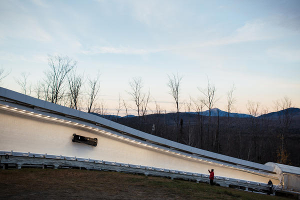 A U.S. sled makes its way through curve 10 on the Lake Placid, N.Y. track during training runs.
