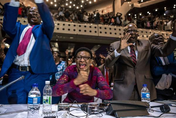 Members of Zimbabwe's parliament celebrate in Harare after Robert Mugabe's resignation on Nov. 21.