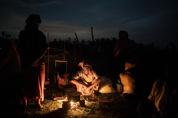 Rohingya refugees cook in  Unchiprang, Bangladesh, on their way to a makeshift camp after crossing from Myanmar, on Sept. 5.