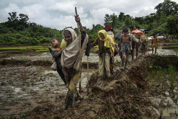 Rohingya Muslims from Myanmar evade border guards and trek over the Chittagong hills after crossing the border illegally near Amtoli, Bangladesh, on Sept. 1.