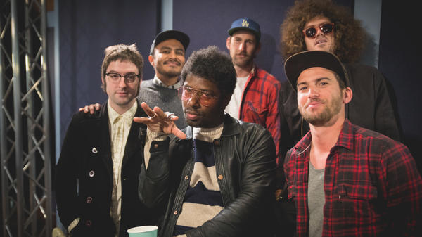 Curtis Harding (center) and his band pose inside the World Cafe Performance Studio.
