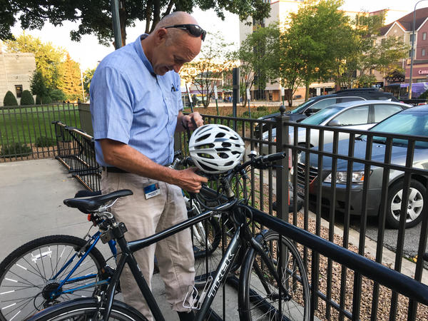 Scientist Michael Joyner rides his bike to work every day because he believes the exercise has more of an impact on people's BMI than their genetic profile.