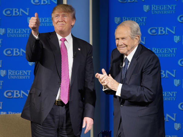 Republican presidential candidate Donald Trump is accompanied by Pat Robertson after speaking at Regent University in Virginia Beach, Va., in February 2016.