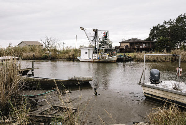 Fishing boats and storage sheds line Bayou Dularge in the tiny fishing village of Theriot.
