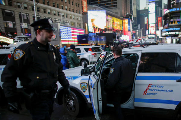 New York Police Department officers prepare for New Year's Eve celebrations in Manhattan's Times Square in New York.
