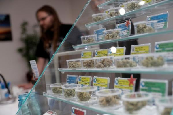 <p>In this Dec. 29, 2017, photo, various kinds of marijuana strains are displayed at the KindPeoples dispensary in Santa Cruz, Calif. Californians may awake on New Year's Day to a stronger-than-normal whiff of marijuana as America's cannabis king lights up to celebrate the state's first legal retail pot sales.</p>